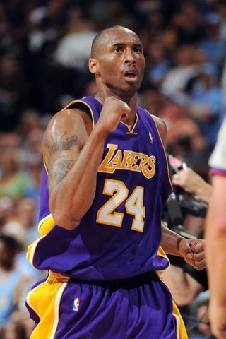 Kobe Bryant fist clenched as he celebrates