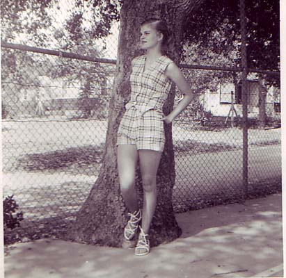 My mom made a lot of my clothes and this green and white seer sucker plaid  shorts and vest outfit was a fav. Check out those Grecian lace up summer  sandals. 865d98469